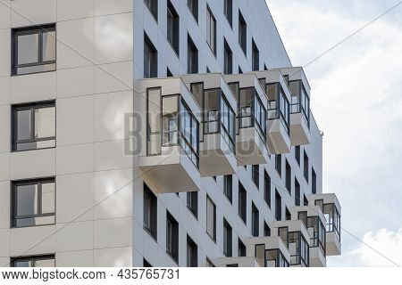 The Facade Of A Modern Residential Multi-storey Building, Viewed From Below. Compact Balconies Close
