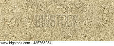Panorama Of Sand Texture. Sandy Beach For Background. Top View. Natural Sand Stone Texture Backgroun