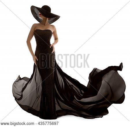 Elegant Fashion Model In Black Dress. Sexy Woman Silhouette In Hat. Luxury Lady In Long Evening Gown