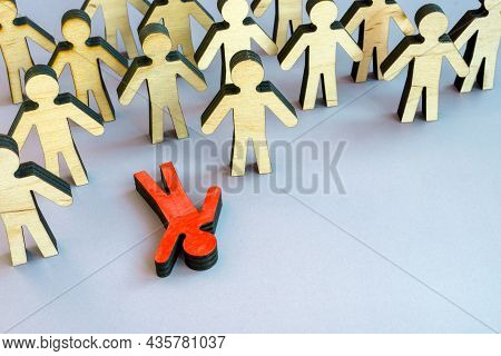 The Figurine Lies In The Crowd. Burnout At Work Or Physical Or Emotional Exhaustion.