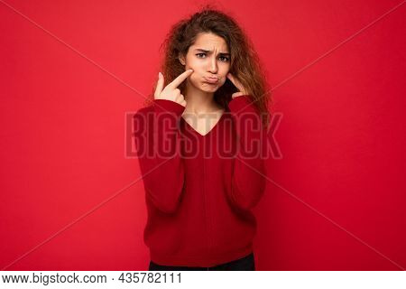 Photo Of Young Touchy Sad Sorrowful Attractive Brunette Curly Woman With Sincere Emotions Wearing Ca