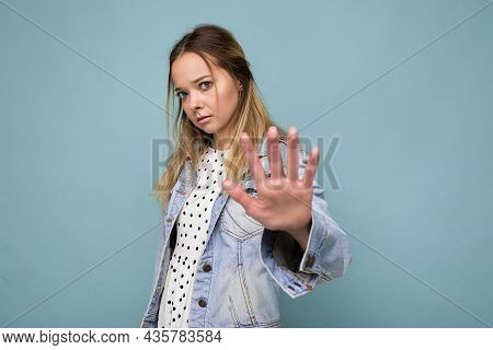 Photo Of Young Sad Upset Beautiful Blonde Woman With Sincere Emotions Wearing Jean Blue Jacket Isola