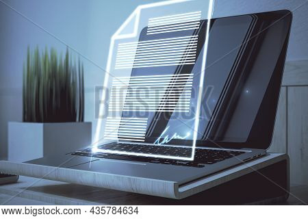 Close Up Of Laptop With Abstract Digital Document Hologram. Electronic Signature And Transformation