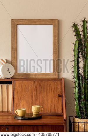 Stylish Retro Composition Of Workspace With Vintage Wooden Cabinet, Cup Of Coffee, Design Pot With C