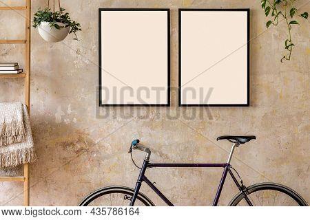 Interior Design Of Living Room With Two Black Poster Mock Up Frames, Bike And Potted Plants. Grunge