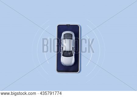 Car Toy And Mobile Phone On Blue Background. Automobile With Gps Tracking Pulsing Signal. A Vehicle