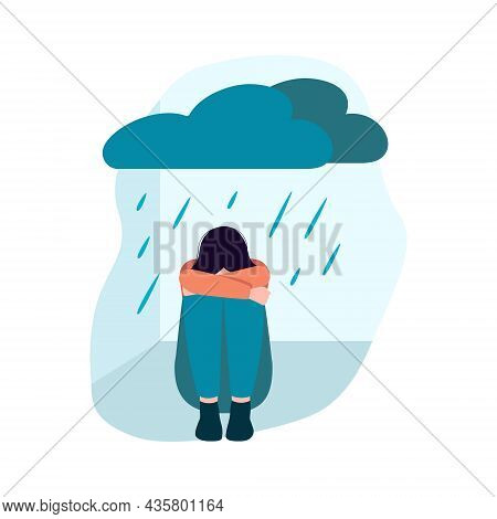 Depressed Girl Sit On The Floor With Cloud And Rain Above. Psychological Issues. Mental Illness And