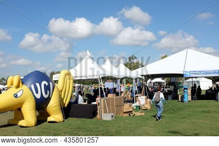 IRVINE, CALIFORNIA - 9 OCT 2021: The UCI Health booth at the Irvine Global Village Festival, offering free Covid-19 Vaccine shots.