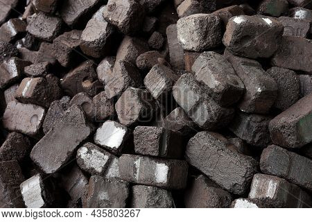 Closeup View Of Black Charcoal, Coal Briquets. Coal Texture Background. Energy Resource, Heating, In