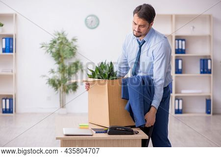 Young male employee in business relocation concept