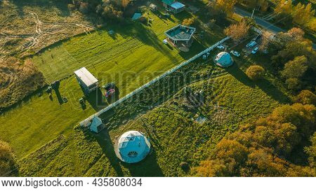 Spherical House In The Village. Round House, Geometric Design For Summer Vacation. Unusual Real Esta