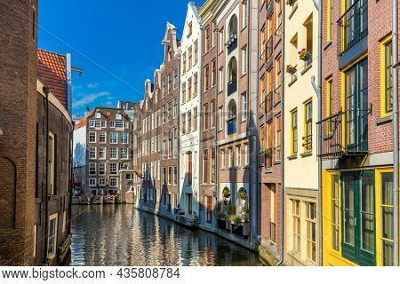 Amazing floating houses of Amsterdam. Old houses are built in the water. A popular place in Amsterdam.Holland, Netherlands, Europe