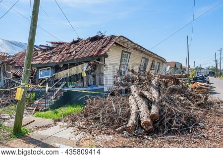 New Orleans, La - October 9: Severely Damaged House And Pile Of Debris From Hurricane Ida On October