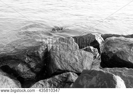 Black And White Photo With Beautiful Wet Stones On Black And White Background In Style Of Old Black