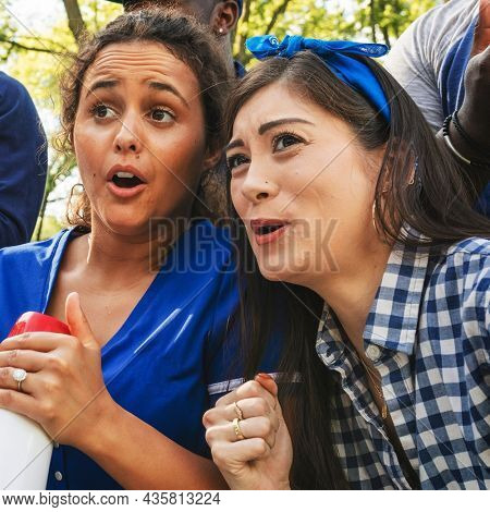 Female baseball supporters watching their team loose the game