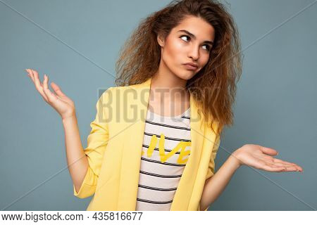 Photo Shot Of Young Thoughtful Thinking Attractive Brunette Curly Woman With Sincere Emotions Wearin