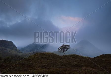 Morning View Of River With Waterfall And Cloud Covered Mountain Range. Scenic Summer Landscape With