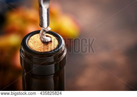 Bottle Wine With Corkscrew. Opening A Wine Bottle With A Corkscrew In A Restaurant. Wine Composition