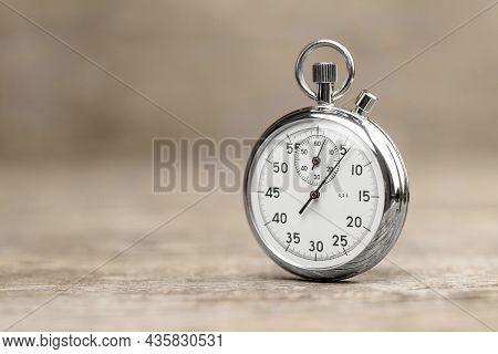 Stopwatch On A Wooden Background. Template Copy Space For Text