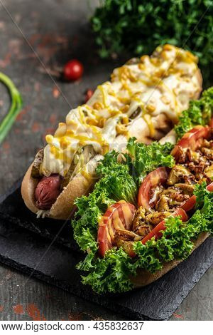 Hotdogs Fully Loaded With Assorted Toppings. Fast Food Hotdog, Fast Food And Junk Food Concept. Vert