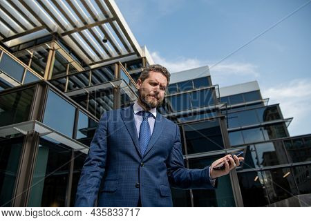Frustrated Entrepreneur In Businesslike Suit Hold Phone Outside The Office, Bankruptcy