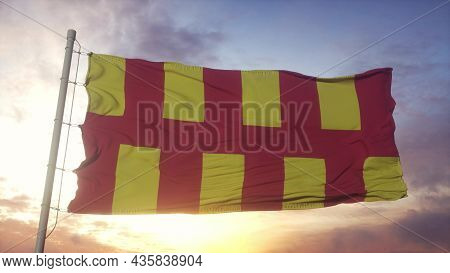 Northumberland Flag, England, Waving In The Wind, Sky And Sun Background. 3d Rendering