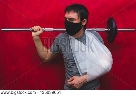 Man With Sprain Bondage Lifts A Barbell With Undistributed Load