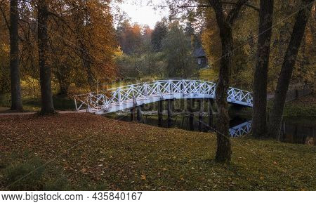 White Bridge In The Pushkin Hills On An Autumn Evening In The Countryside.  Russia