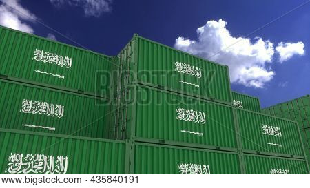 Saudi Arabia Flag Containers Are Located At The Container Terminal. Saudi Arabia Export Or Import Co
