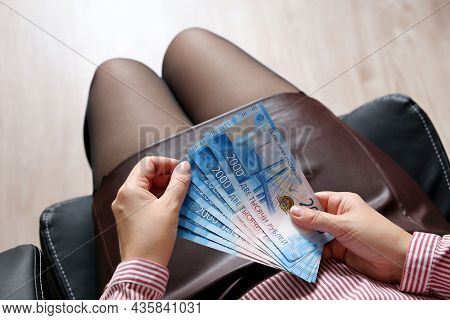 Russian Rubles In Female Hands, Cash Pay, Salary Or Bribe Concept. Woman In Office Clothes Sitting I
