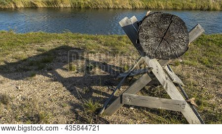 Goat For Sawing Wood. Sawing Wood In Hand On A Rack. Old Wooden Stand For Firewood. A Wooden Trestle