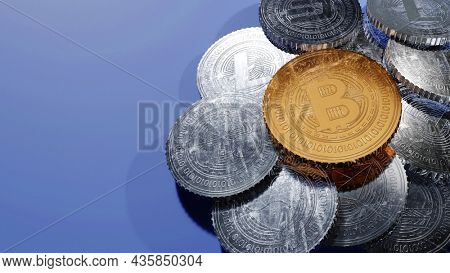 3D Golden And Silver Crypto Coins On Blue Background With Copy Space.