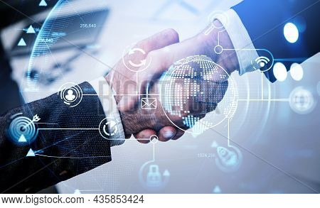Two Businessmen In Formal Suits Shake Hands With Each Other After Making A Profitable Agreement. Off