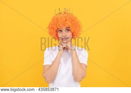 Egoistic Funny Girl With Fancy Look Wearing Orange Hair Wig And Princess Crown, Imagining