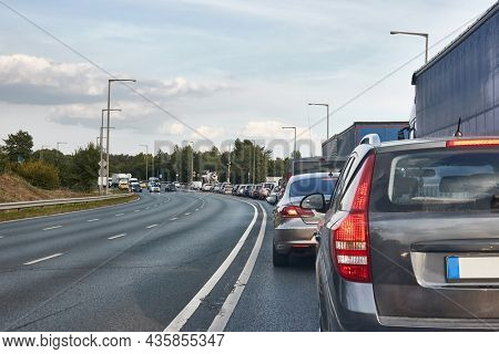 Driving on the road with line of cars waiting at the traffic light