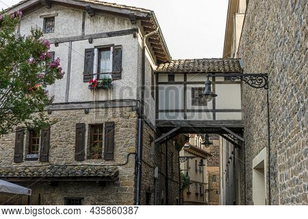 Facade of a medieval building in the center of Pamplona, ??medieval stone streets, typical and tourist alley of the city. Navarra Spain