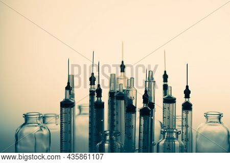 Vials Of Medicine And Silhouette Plastic Syringe With Needle. Needle Phobia. Traditional Method For