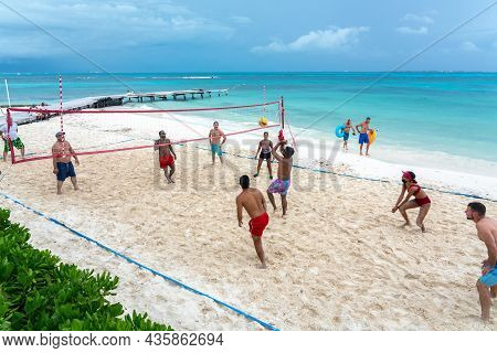 Cancun, Mexico - September 11, 2021: Tourists Playing Volleyball On The Beach In All Inclusive Hotel
