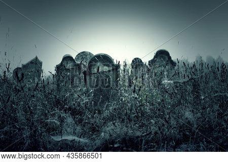 Tombstones in cemetery. Halloween concept.