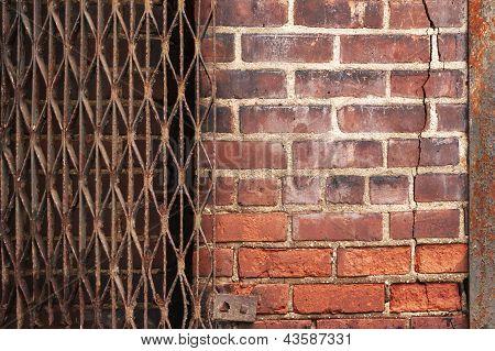 Urban Brick Backgound With Rusty Gate