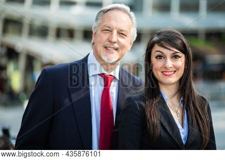 Business partners outdoor in a modern urban setting in daylight