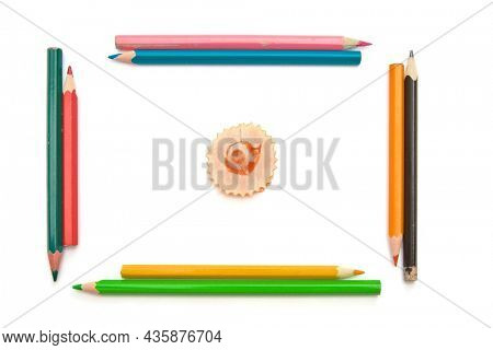 Colorful wood pencils shavings on white background. Isolared object.