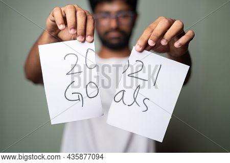 Sad Young Man Tearing 2021 Goals - Concept Of Failure Of 2021 Goals