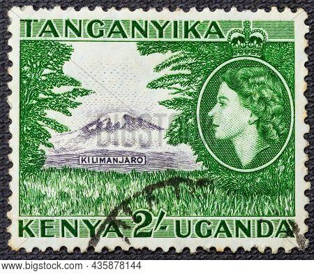 1954: A Stamp Printed In Kenya Uganda Tanganyika Shows A Lion And Queen Elizabeth Ii, Circa 1954.