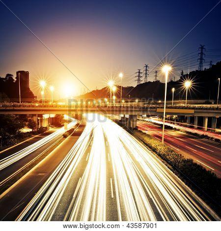 Fast moving cars at night of  china shang hai poster