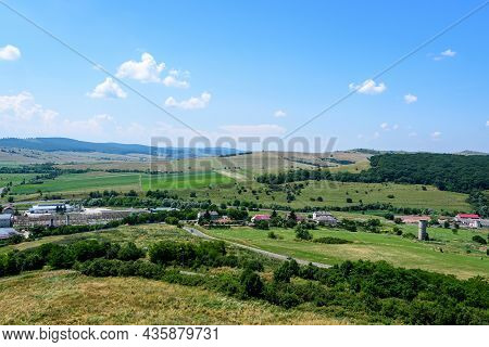 View From The Stone Walls At The Rupea Citadel (cetatea Rupea) After Renovation Towards A Small Town