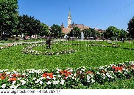 City Landscape With Ferdinand I King Square (piata Regele Ferdinand I) And Green Park In The Old Cit