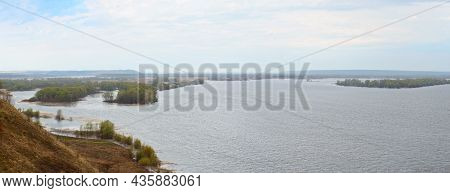 Spring Panorama Of A Wide River , Islands On A Cloudy Rainy Day