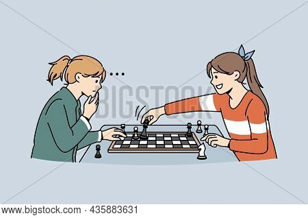 Intellectual Game And Playing Chess Concept. Two Small Girls Sitting Thinking Of Strategy Playing Ch