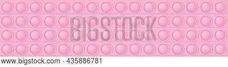 Pop It Pink Background As A Fashionable Silicon Toy For Fidgets. Addictive Anti-stress Toy In Pastel